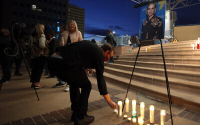 A man takes part in a candlelight vigil to honor cinematographer Halyna Hutchins in Albuquerque, New Mexico, Oct. 23, 2021 (AP Photo/Andres Leighton)