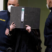 Defendant Jennifer W. arrives in a courtroom for her trial in Munich, Germany, Oct. 25, 2021 (Sven Hoppe/dpa via AP)