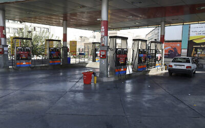 A gas station is seen standing empty because the pumps are out of service, in Tehran, Iran, Tuesday, Oct. 26, 2021. (AP Photo/Vahid Salemi)