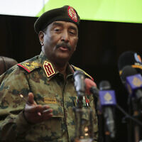 Sudan's head of the military, Gen. Abdel-Fattah Burhan, speaks during a press conference at the General Command of the Armed Forces in Khartoum, Sudan, on October 26, 2021. (AP Photo/Marwan Ali)