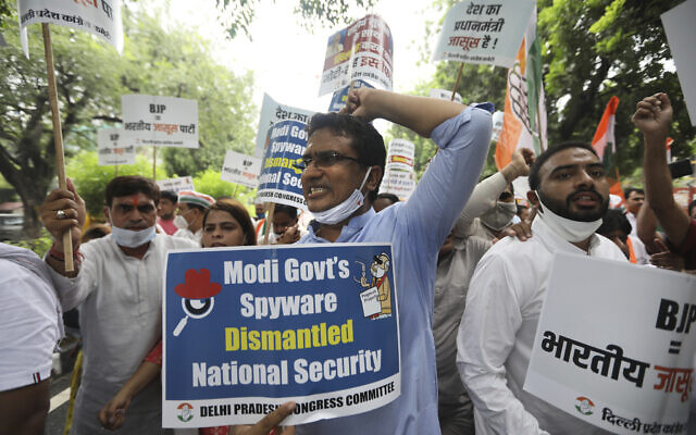 In this July 20, 2021 file photo, Congress party workers shout slogans during a protest accusing Prime Minister Narendra Modi's government of using military-grade spyware to monitor political opponents, journalists and activists in New Delhi, India. (AP Photo/Manish Swarup, File)