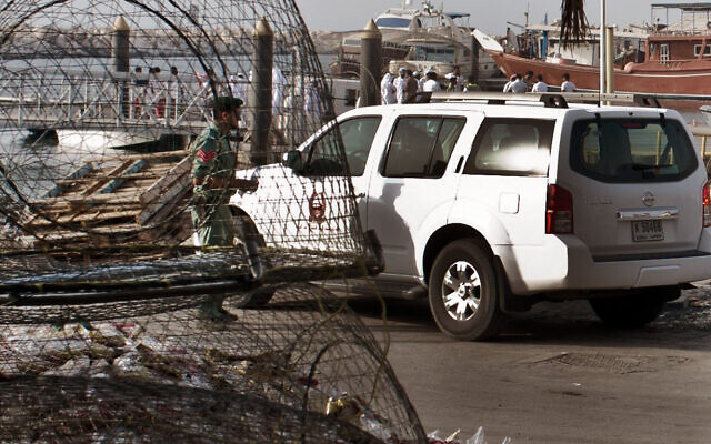 Illustrative: Emirati police and other officials inspect a boat docked in a fishing harbor in the Jumeirah district of Dubai, United Arab Emirates, July 16, 2012.  (AP Photo/Almoutasim Almaskery)