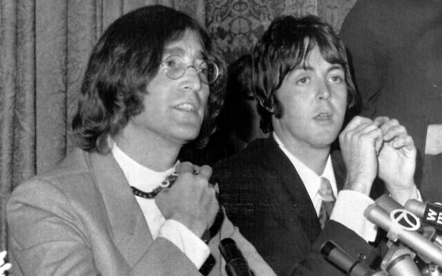 John Lennon, left,and Paul McCartney, announce the establishment of Apple Corps Ltd., in New York, NY, May 15, 1968. The new company, owned equally by all four Beatles, would make films, produce records, and own clothing stores in London. (AP Photo)