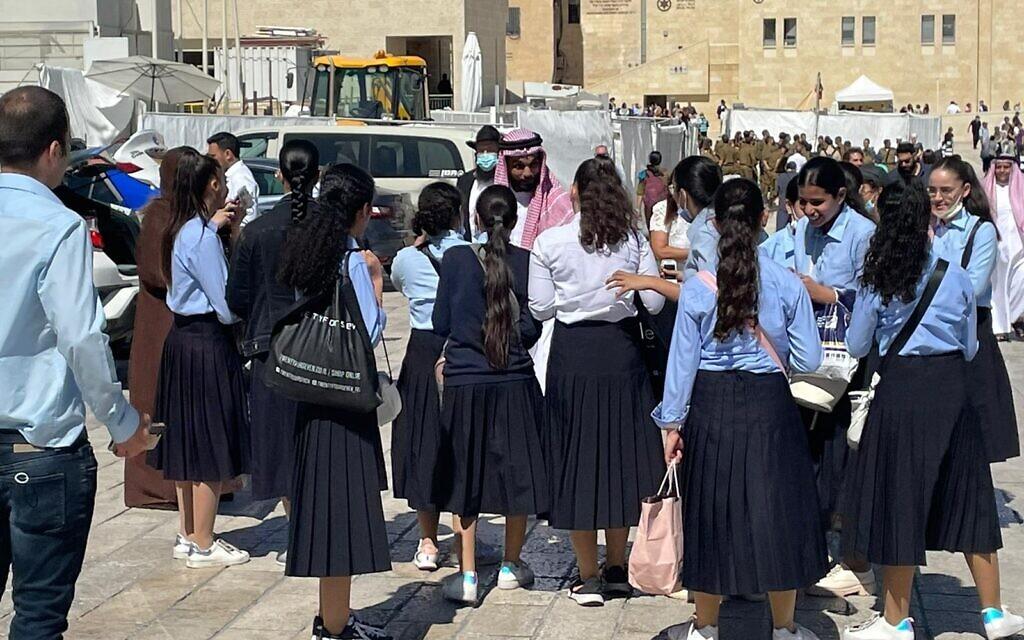 Bahraini acitvist Mohamed Al Shaer speaks with Haredi schoolgirls in the Old City of Jerusalem, October 6, 2021 (Lazar Berman, Times of Israel)
