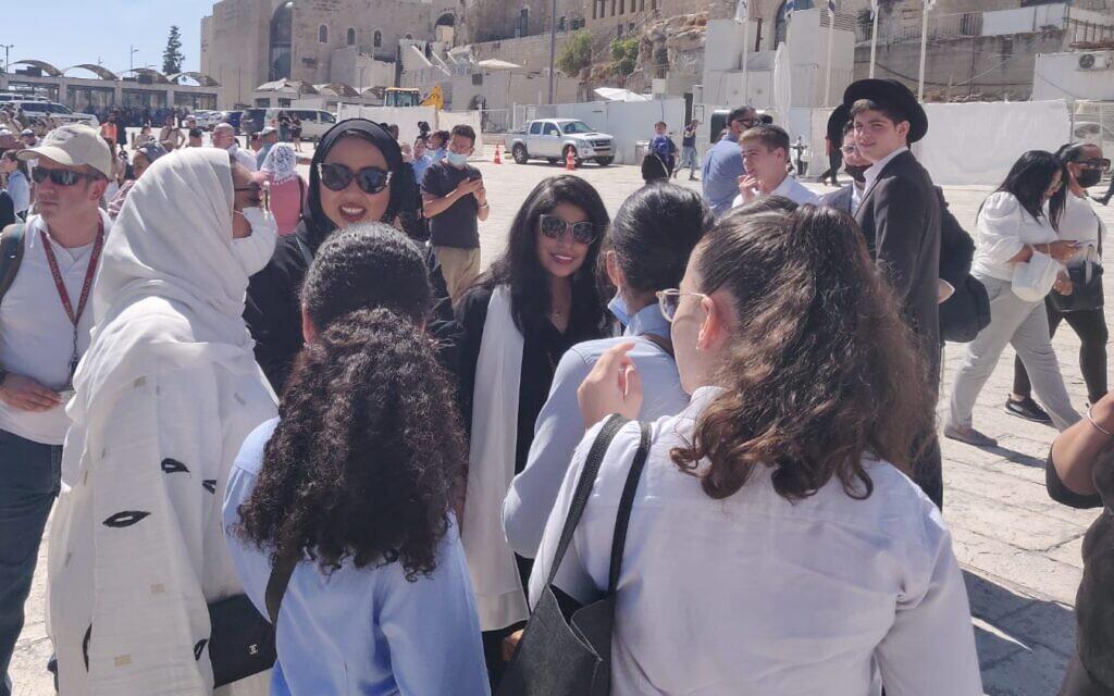 Bahrainis speak with Haredi schoolgirls in the Old City of Jerusalem, October 6, 2021 (Lazar Berman, Times of Israel)