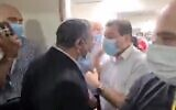 Screen capture from video of an altercation between leader of the far-right Otzma Yehudit party MK Itamar Ben Gvir (center-left) and MK Ayman Odeh, leader of the predimonantly Arab-Israeli Joint List party, at the Kaplan Medical Center in Rehovot, October 19, 2021. (Twitter)