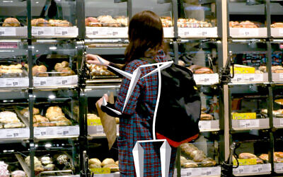 A shopper selects items at a REWE store in Cologne, Germany, that has been outfitted with Trigo's checkout-free, grab-and-go technology. (REWE)