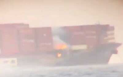 Screen capture from video of a fire aboard the Israeli-owned container ship, MV Zim Kingston, off the coast of Canada, October 24, 2021. (Twitter)