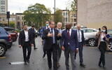 Israeli Ambassador to the US Gilad Erdan walks with Bright Star Church Pastor Chris Harris outside the Bright Star Community Outreach Center in Chicago on October 13, 2021. (Christian Harris)