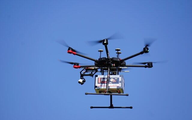 A drone flies near the city of Tel Aviv on October 11, 2021, in a pilot run by the Israel Innovation Authority with partners to create a network of drone deliveries in Israel (Emanuel Fabian/Times of Israel)
