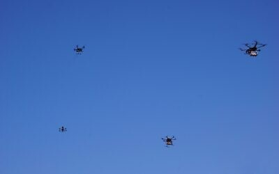 Drones flying near the city of Tel Aviv on October 11, 2021, in a pilot run by the Israel Innovation Authority with partners to create a network of drone deliveries in Israel (Emanuel Fabian/Times of Israel)