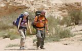 A man and woman walking the Israel Trail. (Miriam Alster/Flash90)