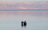 Illustrative -- People in the Dead Sea on March 10, 2017 (Doron Horowitz/Flash90)