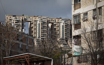 View of the Holyland high-rise buildings next to older apartment buildings in the Gonen neighborhood of Jerusalem, January 19, 2020. (Hadas Parush/Flash90)