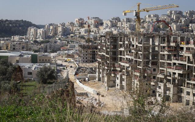 Illustrative: Construction work for new housing in the settlement of Modi'in Illit. January 11, 2021. (Flash90)