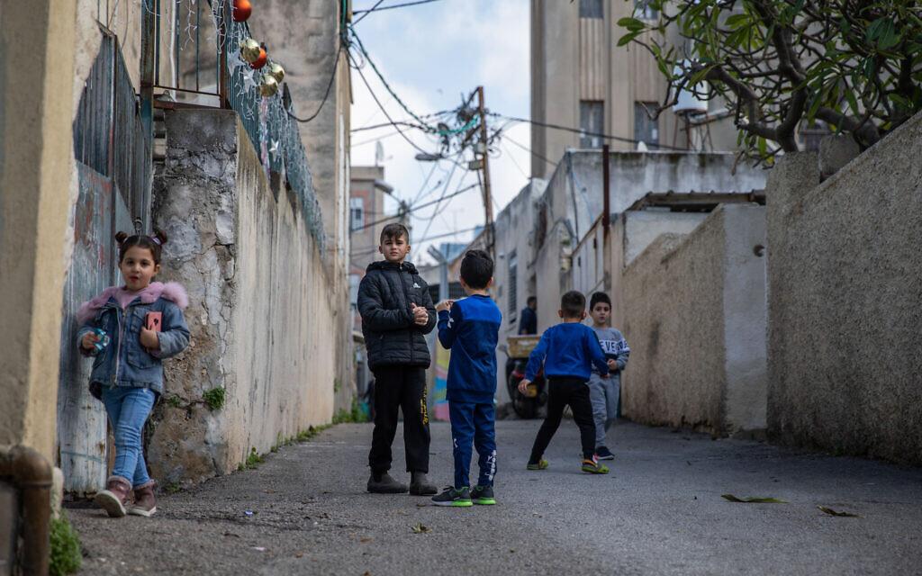 Children play in Wadi Nisnas neighborhood in Haifa on February 5, 2021. Photo by Shir Torem/Flash90