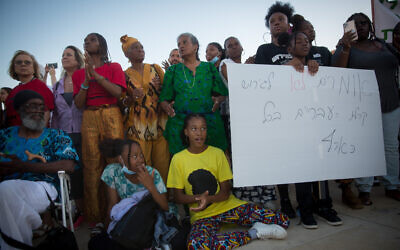 Members of the Black Hebrews community protest against the deportation orders given to some members of the community, at Habima Square in Tel Aviv, June 1, 2021. (Miriam Alster/Flash90)