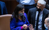Foreign Minister Yair Lapid, right, and Interior Minister Ayelet Shaked are seen in the Knesset in Jerusalem, July 6, 2021.(Yonatan Sindel/Flash90)