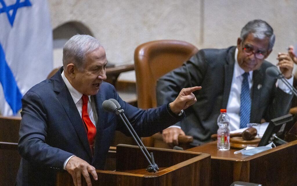Opposition leader Benjamin Netanyahu speaking in the Knesset plenum alongside Knesset Speaker Miki Levy on July 12, 2021. (Olivier Fitoussi/Flash90)