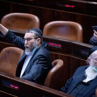 MK Moshe Gafni (left) alongside Yaakov Litzman in the Knesset, on July 26, 2021.(Yonatan Sindel/Flash90)