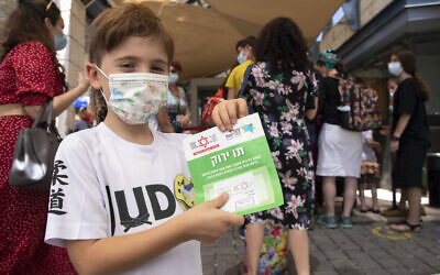 Children are eligible for a Green Pass due to testing negative for coronavirus (PCR swab test) in the last 24 hours, they will be included in their parents' Green Pass. (Courtesy Olivier Fitoussi/Flash90)