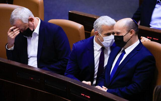 Prime Minister Naftali Bennett (right), Foreign Minister Yair Lapid (center) and Defense Minister Benny Gantz at the Knesset, on September 2, 2021. (Olivier Fitoussi/Flash90)
