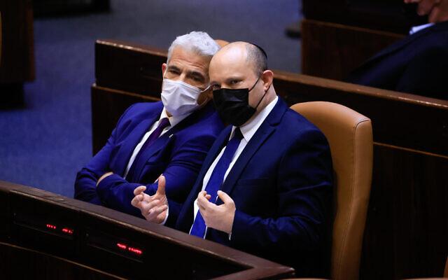 Prime Minister Naftali Bennett (right) and Foreign Minister Yair Lapid speak at the Knesset, on September 2, 2021. (Olivier Fitoussi/Flash90)