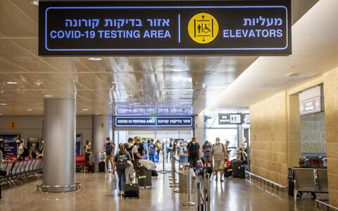 Travelers are seen at Ben Gurion Airport near Tel Aviv on September 20, 2021. (Nati Shohat/Flash90)