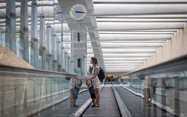 Travelers are seen at Ben Gurion Airport near Tel Aviv on September 6, 2021. (Yonatan Sindel/Flash90)