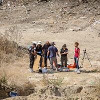 Police at the scene where the body of 17-year-old Lital Yael Melnik was found, on a construction site, in Kiryat Motzkin, October 2, 2021. (Alon Nadav/Flash90)