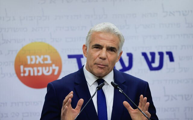 Yesh Atid party leader Yair Lapid speaks during a faction meeting at the Knesset in Jerusalem, October 4, 2021. (Oliiver Fitoussi/Flash90)