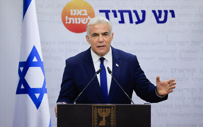 Yesh Atid party leader Yair Lapid speaks during a faction meeting at the Knesset on October 4, 2021. (Olivier Fitoussi/Flash90)