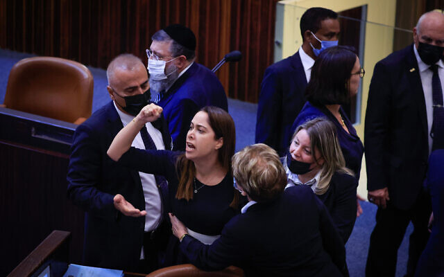 Likud MK May Golan is ejected from the opening plenary session of the Knesset's winter session, on October 4, 2021. (Olivier Fitoussi/Flash90)