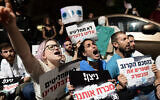 Medical interns demonstrate for better work conditions in Tel Aviv, on October 4, 2021. (Tomer Neuberg/Flash90)
