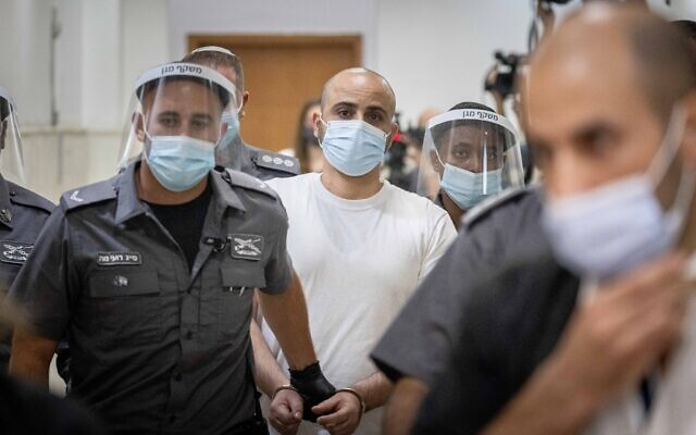 Eliran Malul, charged with stabbing to death his wife Michal Sela at their home in Ramat Motza, seen after a court hearing at the Jerusalem District Court on October 6, 2021. (Yonatan Sindel/Flash90)