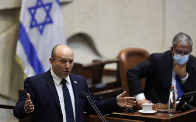 Prime Minister Naftali Bennett addresses the Knesset plenum on October 11, 2021. (Yonatan Sindel/Flash90)