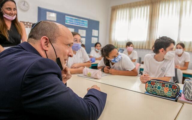 Prime Minister Naftali Bennett visits students at the Ramon School in Modi'in, on October 12, 2021.(Yossi Aloni/Flash90)