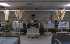 Empty beds are seen in the intensive care unit at the coronavirus ward of Shaare Zedek hospital in Jerusalem on October 14, 2021. (Olivier Fitoussi/Flash90)