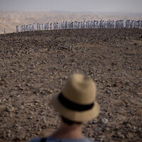 A few hundred naked people covered in white paint pose for a group picture taken by Spencer Tunick, outside Arad in southern Israel, October 17, 2021. (Yonatan Sindel/Flash90)