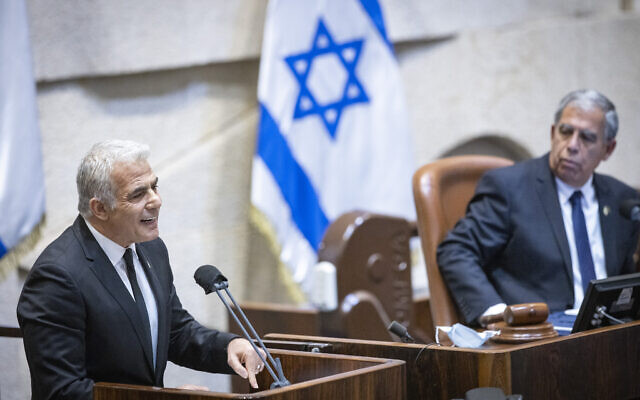 Foreign Minister Yair Lapid speaks during memorial ceremony marking 26 years since the assassination of prime minister Yitzhak Rabin, at the Knesset, on October 18, 2021. (Olivier Fitoussi/Flash90)