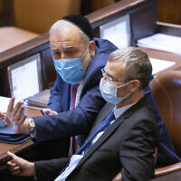 Head of the Shas party Aryeh Deri and Likud's Yariv Levin, at the Knesset, Israel's parliament, in Jerusalem, on October 18, 2021. (Olivier Fitoussi/Flash90)