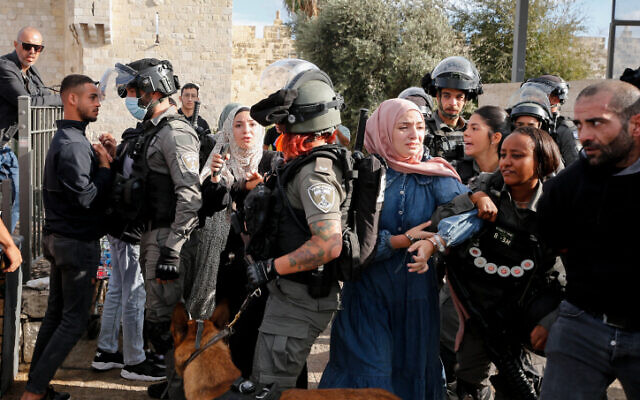 Palestinians clash with police during a protest at Damascus Gate in Jerusalem's Old City on October 19, 2021 (Jamal Awad/Flash90)