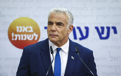 Foreign Minister Yair Lapid speaks during a Yesh Atid faction meeting at the Knesset, on October 25, 2021. (Yonatan Sindel/Flash90)