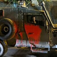 A Border Police vehicle is seen after it was attacked with stones and buckets of paint, near Yitzhar in the West Bank, on October 11, 2021. (Israel Police)