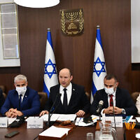 Prime Minister Naftali Bennett (C) and other ministers attend a cabinet meeting at the Prime Minister's Office in Jerusalem on October 24, 2021. (Haim Zach/GPO)