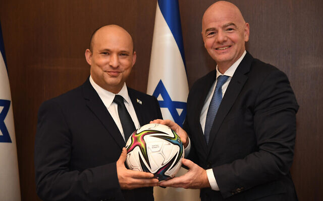Prime Minister Naftali Bennett meets with FIFA President Gianni Infantino, on October 12, 2021. (Haim Zach/GPO)