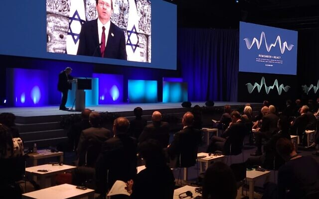 President Isaac Herzog addresses the  Remember ReAct Forum in Malmo, Swden, October 13, 2021 ( Shahar Azran)