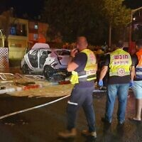 First responders at the scene of a car explosion in the northern coastal city of Nahariya, on October 21, 2021, in which two people were seriously hurt. (Magen David Adom)