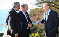Prime Minister Naftali Bennett (C) speaks with Russian President Vladimir Putin (R) while accompanied by Housing Minister Ze'ev Elkin who acted as a translator at Putin's residence in Sochi, Russia on October 22, 2021 (Kobi Gidon/GPO)