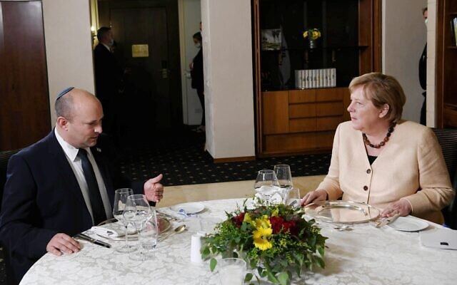Prime Minister Naftali Bennett (L) hosts German Chancellor Angela Merkel for a private dinner in Jerusalem on October 10, 2021. (Koby Gideon/GPO)